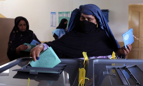An Afghan woman casts her vote at a polling station in Jalalabad east of Kabul, Afghanistan, Saturday, April 5, 2014.