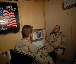 A staff psychiatrist in Kandahar, Afghanistan, evaluates a soldier