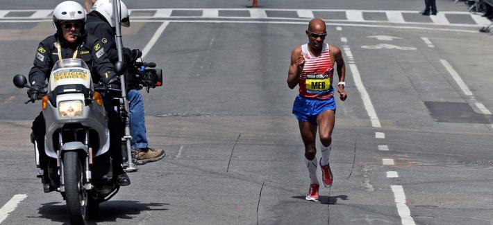 Meb Keflezighi runs the final few blocks before winning the 118th Boston Marathon Monday, April 21, 2014 in Boston.