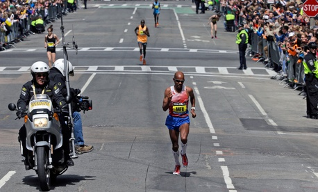 Meb Keflezighi runs the final few blocks before winning the 118th Boston Marathon Monday, April 21, 2014 in Boston.