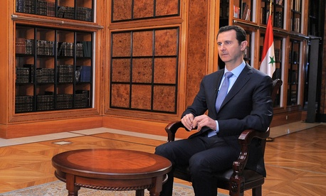 Syrian president Bashar al-Assad sitting down for an interview with Syrian state TV in January 2014.