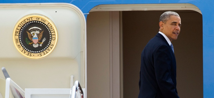 President Obama looking back before departing on Air Force One for his four country Asia trip