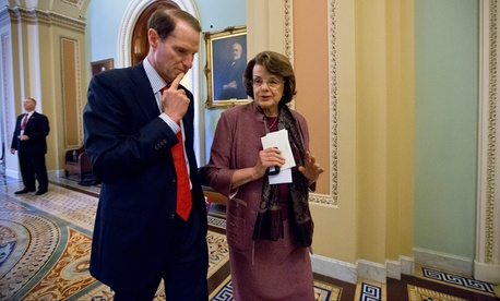 Sen. Ron Wyden, D-Ore., walks with Sen. Dianne Feinstein, D-Calif. on Capitol Hill in June 2013.