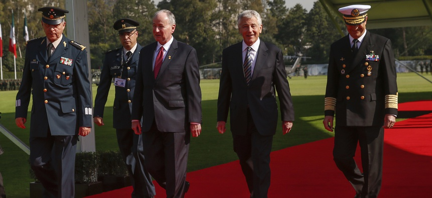 Defense Secretary Chuck Hagel with Canadian Defense Minister Rob Nicholson and Mexican Gen. Salvador Cienfuegos during a reception in Mexico City on Thursday.