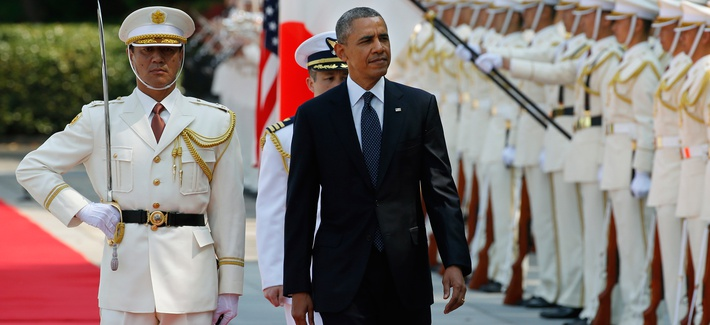 President Barack Obama reviews an honor guard during a welcome ceremony at the Imperial Palace in Tokyo, Thursday, April 24, 2014.