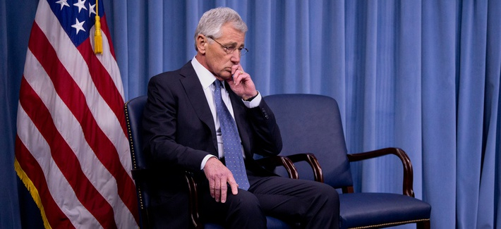 Defense Secretary Chuck Hagel takes at seat at the Pentagon after briefing reporters on his department's proposal to shrink the Army to its smallest size in more than six decades, Monday, Feb. 24, 2014.