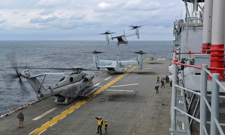 A group of MV-22 Ospreys taking off from the USS Bonhomme Richard during operations in the East China Sea