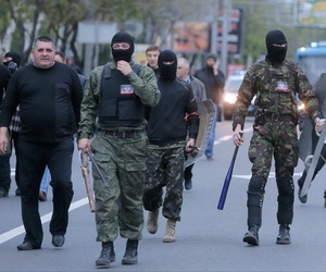 Masked pro-Russian activists walk down the streets of Donetsk, Ukraine on April 28.