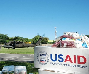 Two UH-60 helicopters prepare to pick up supplies en route to Ostuma, El Salvador, as part of a disaster relief effort after heavy rainstorms in the country