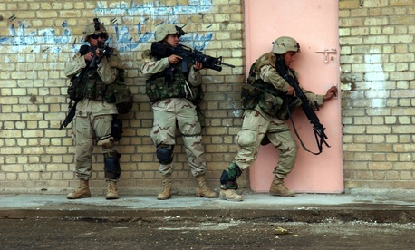 Soldiers from the 2nd Battalion, 5th Cavalry Regiment, 2nd Brigade Combat Team enter a building in Fallujah, Iraq, during Operation Al Fajr on Nov. 9, 2004.