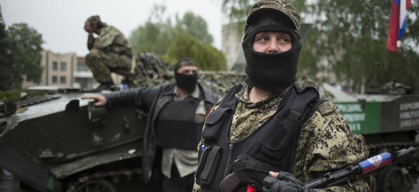 Pro-Russian gunmen guard the central square of Slovyansk, eastern Ukraine, Friday, May 2, 2014.