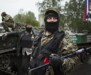Pro-Russian gunmen guard the central square of Slovyansk, eastern Ukraine, Friday, May 2, 2014.