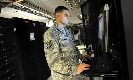 A non-commissioned officer with the 627th Communications Squadron works on a computer system at Joint Base Lewis-McChord in Washington
