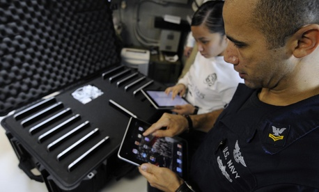 Sailors aboard the USS Carl Vinson upload geographic information using iPads