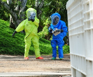 Two soldiers with the 9th Civil Support Team, California National Guard, identify hazardous materials during a training in Kaneohe Bay, Hawaii.