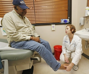 A nurse checks on a veteran at the Montgomery Medical Center in Jackson, Miss., May 15, 2013.