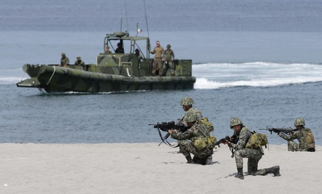 Philippine marines take their positions during an exercise Balikatan 2014 at the Naval Training Exercise Command in the Philippines on May 9, 2014.