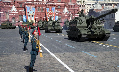 Russian howitzers move along Red Square during a Victory Day Parade in Moscow on May 9, 2014.