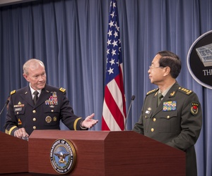 Joint Chiefs Chairman Gen. Martin Dempsey welcomes Gen. Fang Fenghui, chief of general staff for the People's Liberation Army, during a joint press conference Thursday at the Pentagon.
