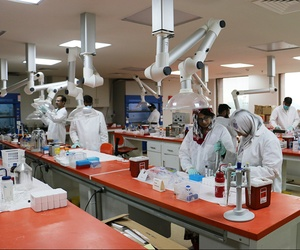 Scientists at a forensics laboratory in Lahore, Pakistan, work to find material to be later used in court proceedings.