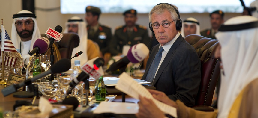 Defense Secretary Chuck Hagel listens to his Saudi counterpart Salman bin Abdulaziz Al Saud at the Gulf Cooperation Council Defense Ministerial in Jeddah, Saudi Arabia, May 14, 2014.