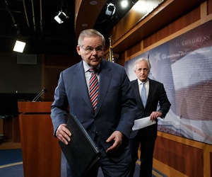 Senate Foreign Relations Committee Chairman Sen. Robert Menendez, D-N.J., left, and the committee's ranking member, Sen. Bob Corker, R-Tenn. depart Capitol Hill following a press conference on Ukraine aid on March 27, 2014.
