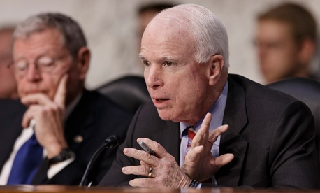 Sen. John McCain, R-Ariz., questions Defense Secretary Chuck Hagel on Capitol Hill in Washington, March 5, 2014, during the Senate Armed Services Committee hearing on the Pentagon's fiscal year 2015 budget.