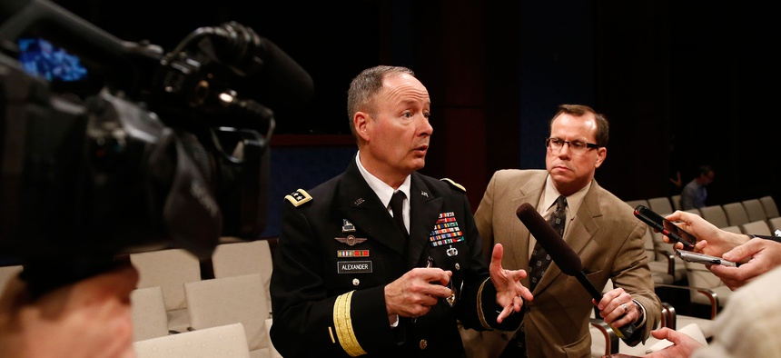 Former NSA Director retired Gen. Keith Alexander, pictured here last June, speaks to reporters after a hearing on Capitol Hill.