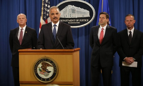 Attorney General Eric Holder announces criminal charges against 5 Chinese hackers at a press conference in Washington on May 19, 2014.