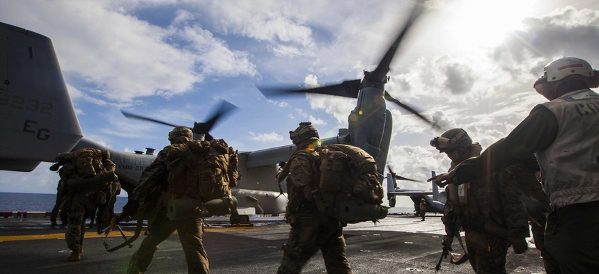 Troops with the 22nd Marine Expeditionary Unit load onto an MV-22 Osprey before a bilateral exercise with the Hellenic Army on March 7, 2014.