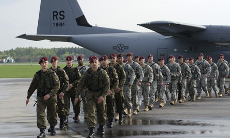 Paratroopers with the 173rd Infantry Brigade Combat Team march with members of the Polish Army's 6th Airborne Brigade at Swidwin Air Base, Poland, on April 23, 2014.