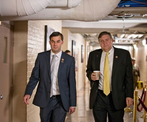 Rep. Justin Amash, R-Mich., walks with Rep. Dan Benishek, R-Mich., after a strategy session on Capitol Hill on October 8, 2013.