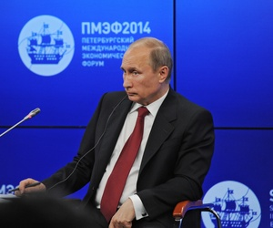 Russian President Vladimir Putin listens to a question during a plenary session of the St. Petersburg International Investment Forum Friday, May 23, 2014.