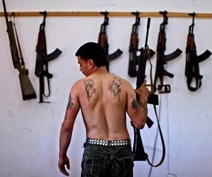 A Syrian rebel fighter poses after returning from fighting against Syrian army forces in Aleppo, Aug. 26, 2012.
