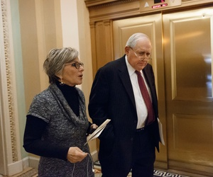 Senate Armed Services Committee Chairman Carl Levin, D-Mich., talks with Sen. Barbara Boxer, D-Calif., ahead of a vote on the 2014 defense bill, at the Capitol in Washington, Dec. 19, 2013.