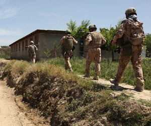Army soldiers from the Czech Republic and the U.S. Army's 1st Mechanized Company, 41st Battalion, 4th Rapid Deployment Brigade, patrol through the village of Dehe-Qadzi in Parwan province on Tuesday.