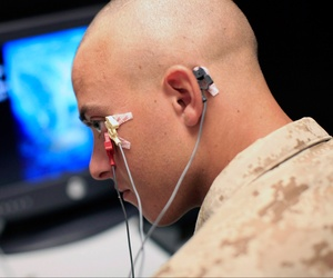 A Marine sits through an eye blink study with sensors attached to his face while taking psychological tests at the Marine Corps Air Ground Combat Center in Twentynine Palms, Calif., Sept. 29, 2009.