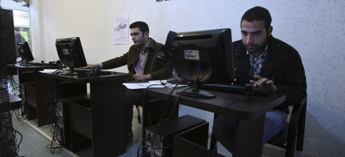 Iranian journalism students use computers in an internet cafe in central Tehran, Iran, Jan. 18, 2011.