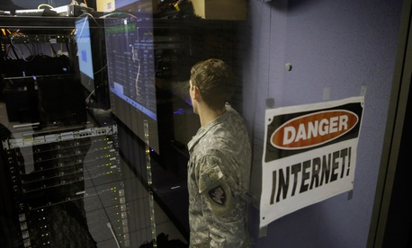 A United States Military Academy cadet checks computers at the Cyber Research Center at the United States Military Academy in West Point, N.Y., April 9, 2014.
