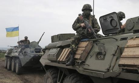 Ukrainian army paratroopers move to position in Slovyansk, Ukraine, on Saturday.