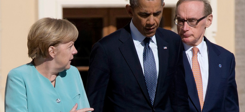 President Barack Obama walks with Germany's Chancellor Angela Merkel and Australian Foreign Minister Bob Carr in St. Petersburg, Russia on Sept. 6, 2013. Leaders discussed Syria's civil war at the summit but made no agreement on military intervention.
