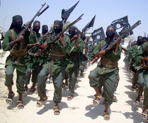 Al-Shabab fighters march with their weapons during military exercises on the outskirts of Mogadishu, Somalia, Feb. 17, 2011. At least twice in 2013 Twitter shut down the handle of al-Shabab.