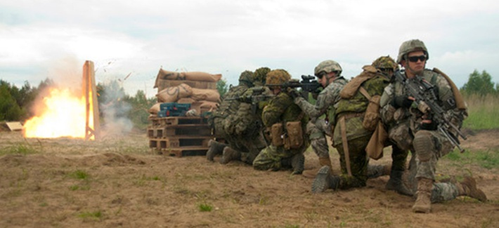 Paratroopers from the Army's 173rd Airborne Brigade participate in a breaching exercise with Canadian and Polish troops on May 27, 2014.