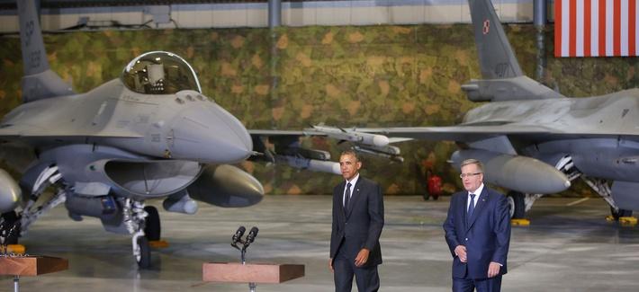 President Obama walks towards the podium before a press conference with Polish President Bronislaw Komorowski on June 3, 2014.