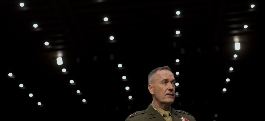 ISAF Commander Gen. Joseph Dunford Jr. arrives for a hearing on Capitol Hill on March 12, 2014.