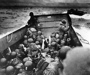 A Coast Guard landing barge packed with soldiers prepares to land at Normandy France on June 6, 1944.