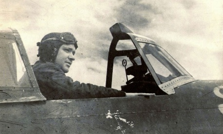 A photo of the author's father, Thomas Tierney, in a P-47 fighter plane during World War 2.