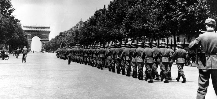German troops march down the Champs-Élysées in Paris, on Sept 8, 1944.