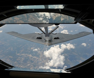 A KC-135 Stratotanker with the 22nd Air Refueling Wing refuels a B-2 Spirit on July 12, 2012.
