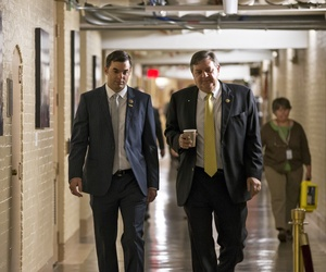 Reps. Dan Benishek, R-Mich., (right) and Justin Amash, R-Mich., walk down a hallway in the Capitol on October 8, 2013.